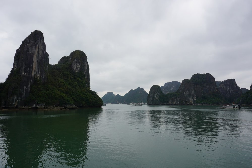 View of Ha Long Bay with a few boats. boldlygotravel.com