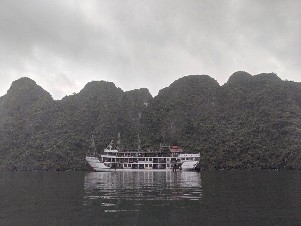 View of one of the many boats that sail through Ha Long Bay, Vietnam. boldlygotravel.com