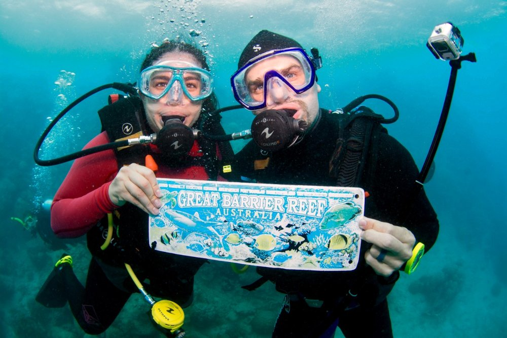 Matt and Kelly dive at the Great Barrier Reef. boldlygotravel.com