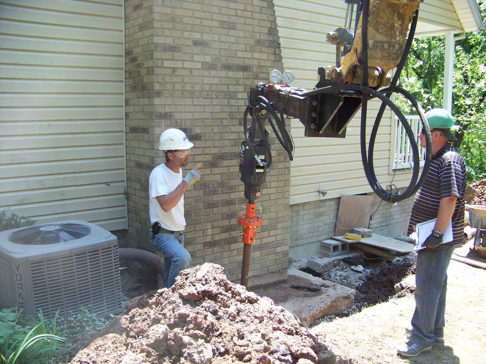 Foundation repair helical piers