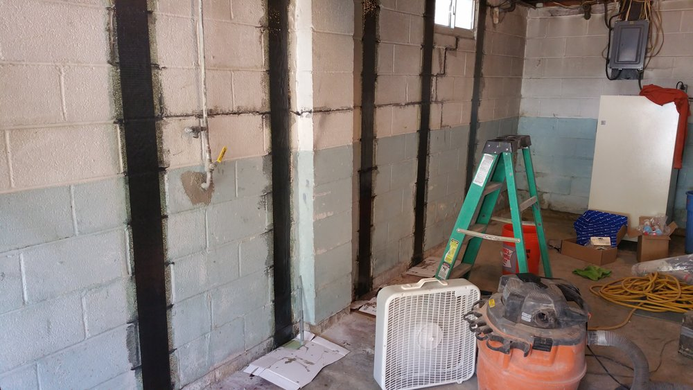 Carbon fiber strips basement wall repair