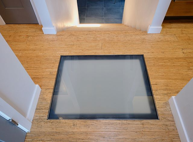 "THERE BE LIGHT - FLOOR SKYLIGHTS  Often there are areas in a house that have very little daylight, making the spaces feel dark and oppressive. Many times a skylight or a solar tube will do the trick. But what if the space needing some more daylight is on a lower floor - you create a floor skylight. That is what we did in this home to bring daylight into the laundry area downstairs.  A ""skylight"" is installed in the floor above that also added some fun visual interest in the hallway on the floor above. #floorskylight"