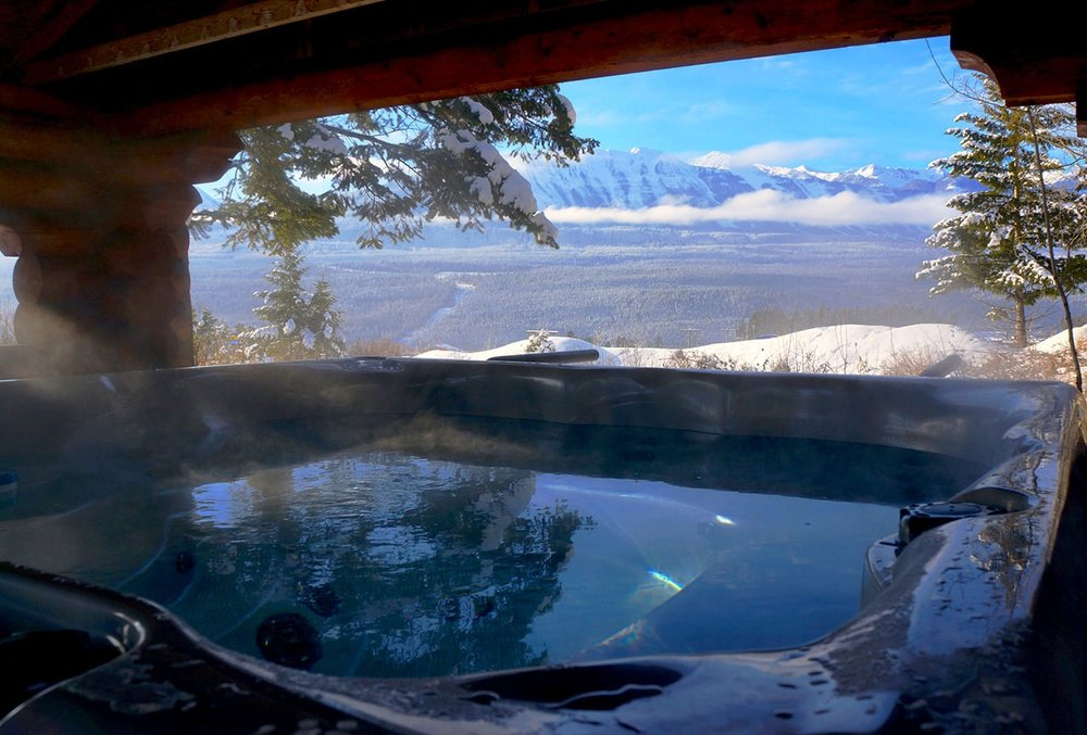 Hot Tub   Warm up after a day in the snow.  Soothe your muscles.  Enjoy a drink with a mountain view.  Experience the silence.  Take comfort in the warmth.  It doesn't matter why you want to enjoy the hot tub - just know that it's an option while you're here.