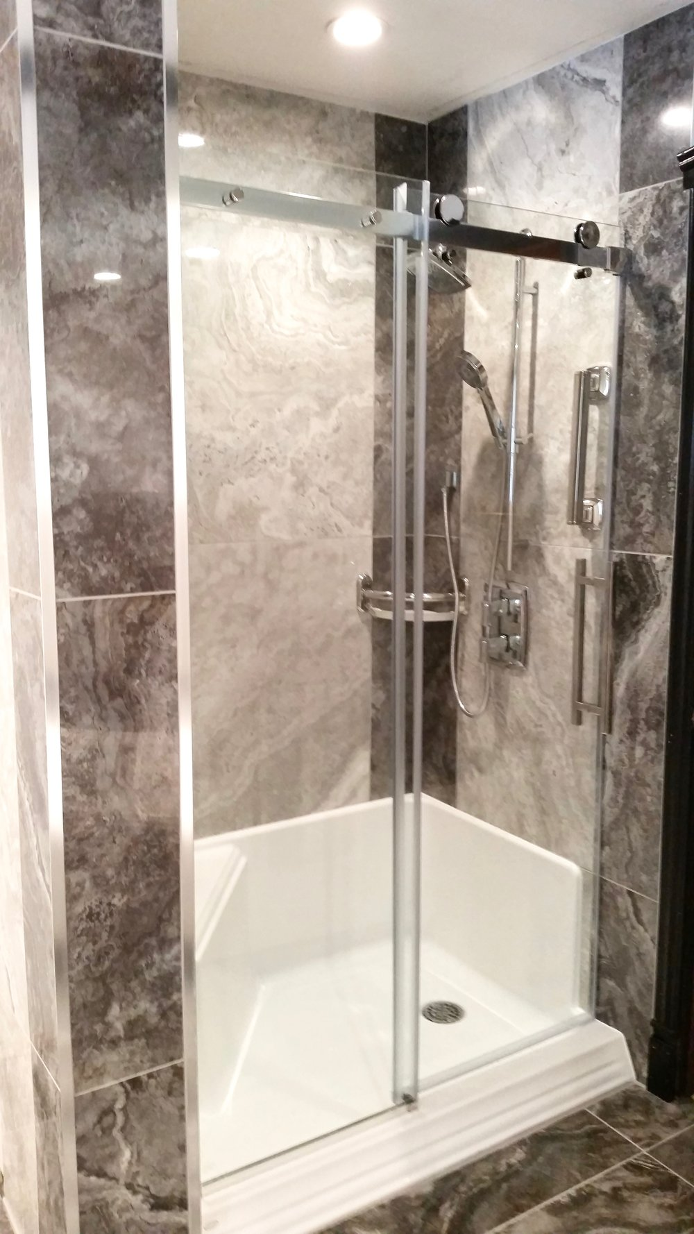 Shower stall with custom glass