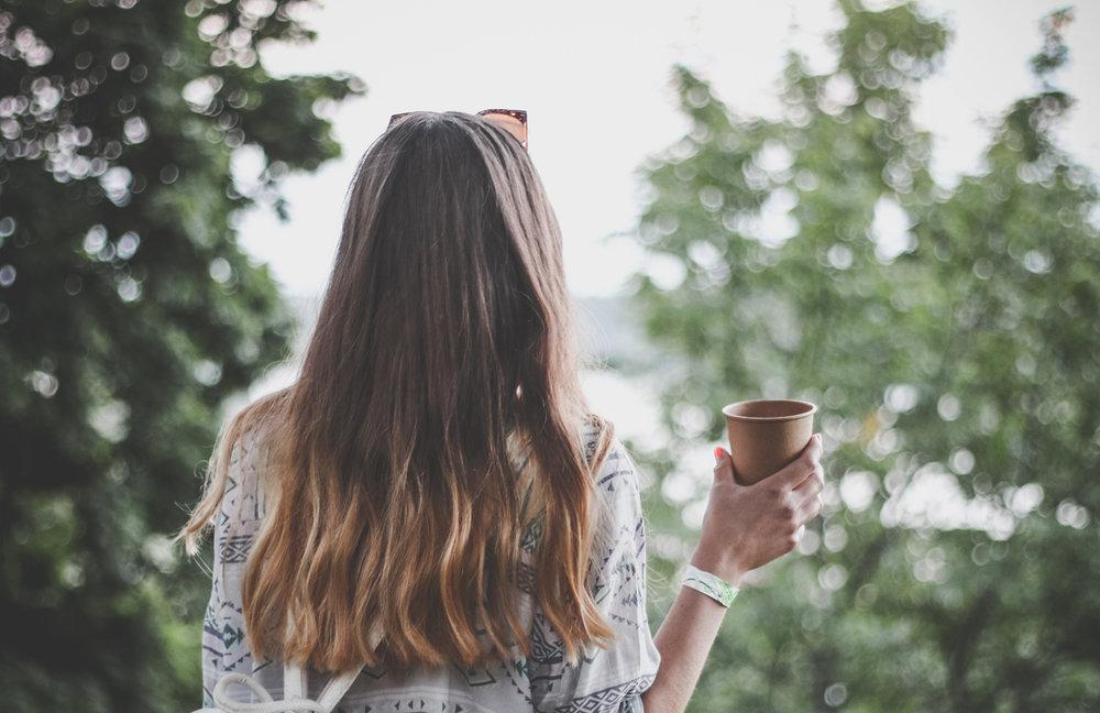girl's back with a coffee kleiner crop.jpg