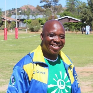 Coach Roy Nyasha Zhou  Roy has been coaching rugby in Lesotho since 2012. As well as co-developing the Lesotho Rugby Academy syllabus and delivering it in over 50 schools, Roy established the Maseru Warriors Rugby Club and coaches the Lesotho national team, the Likoatola (Stallions). He is World Rugby Level 1 qualified. Roy previously worked as an accountant. He is a pastor, and is trained in topics such as HIV awareness, gender and health.