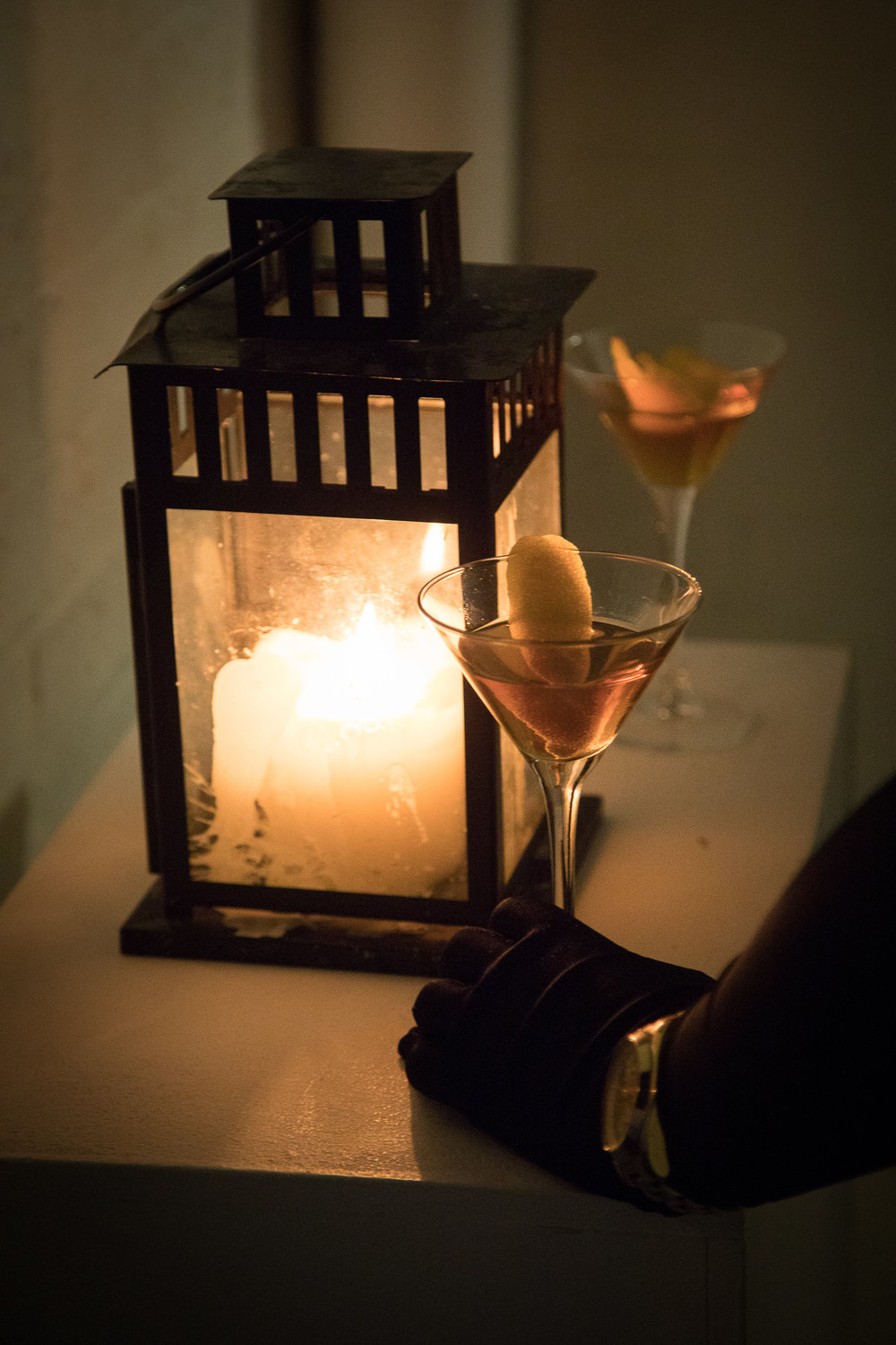 Cocktail glasses, evening gloves and a candle lantern