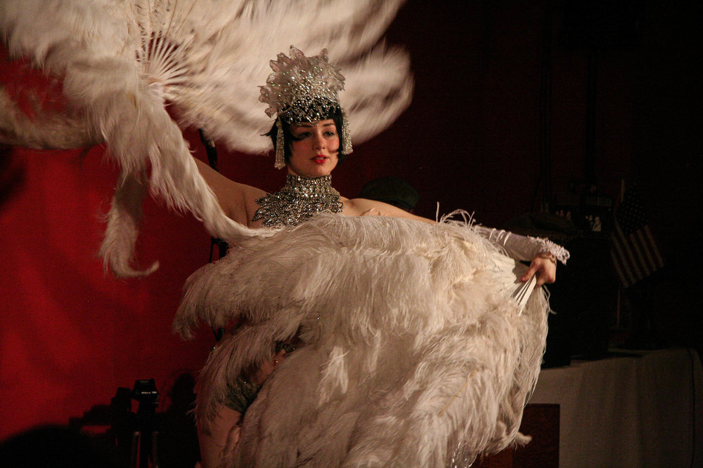 Vicky Butterfly performs fan dance burlesque