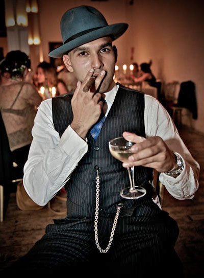 Man in pinstripe gangster suit with cigar