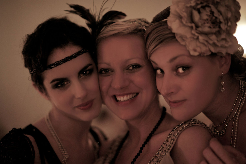 Three flapper ladies cheek to cheek