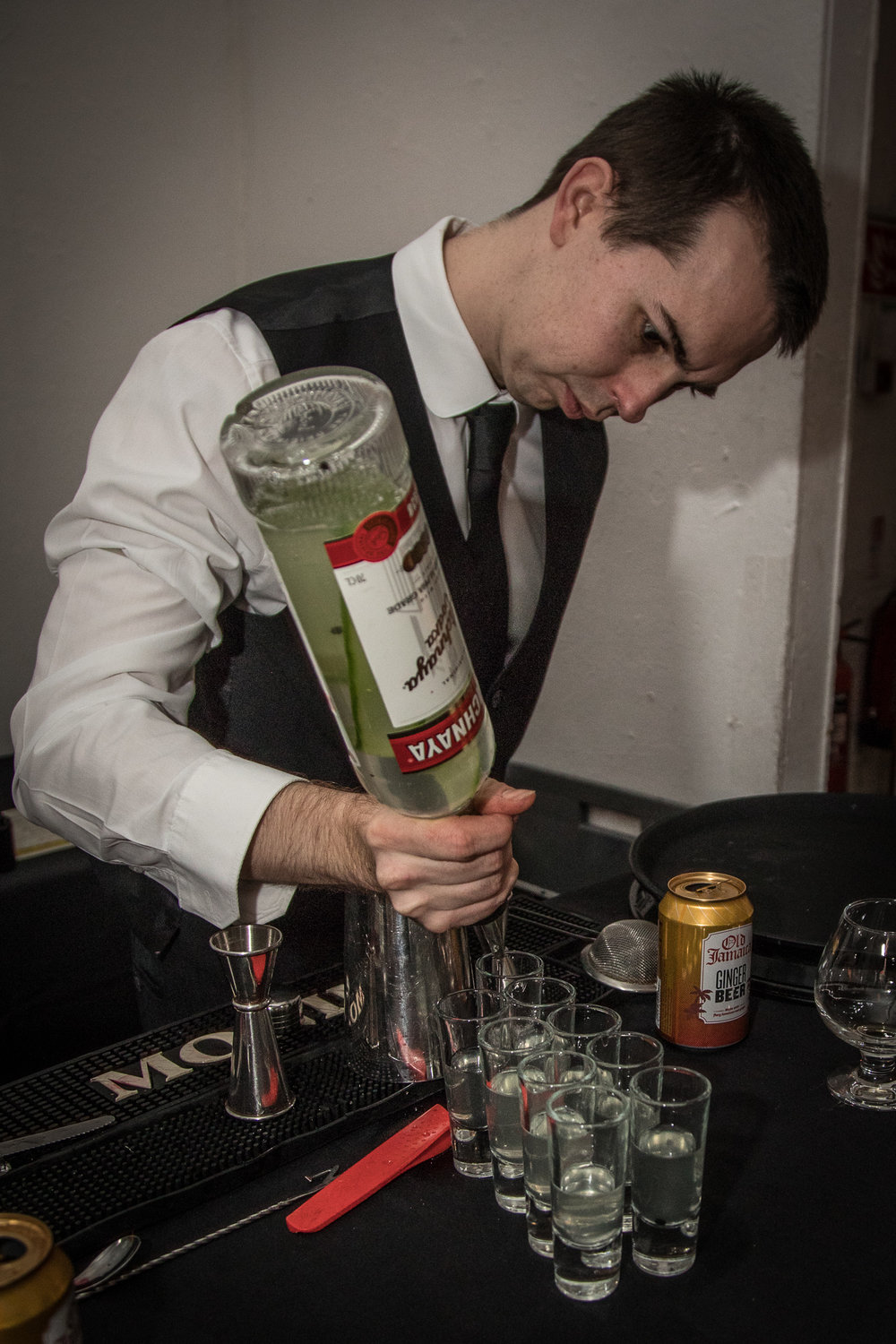 Pouring infused Stolichnaya shots.jpg