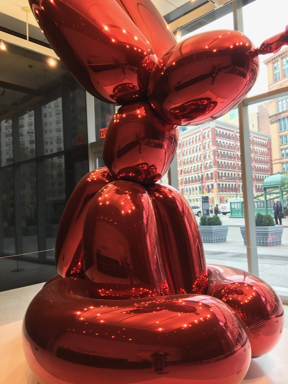 There's a red balloon rabbit sitting in the lobby of 51 Astor Place, but that is not its proper name. -