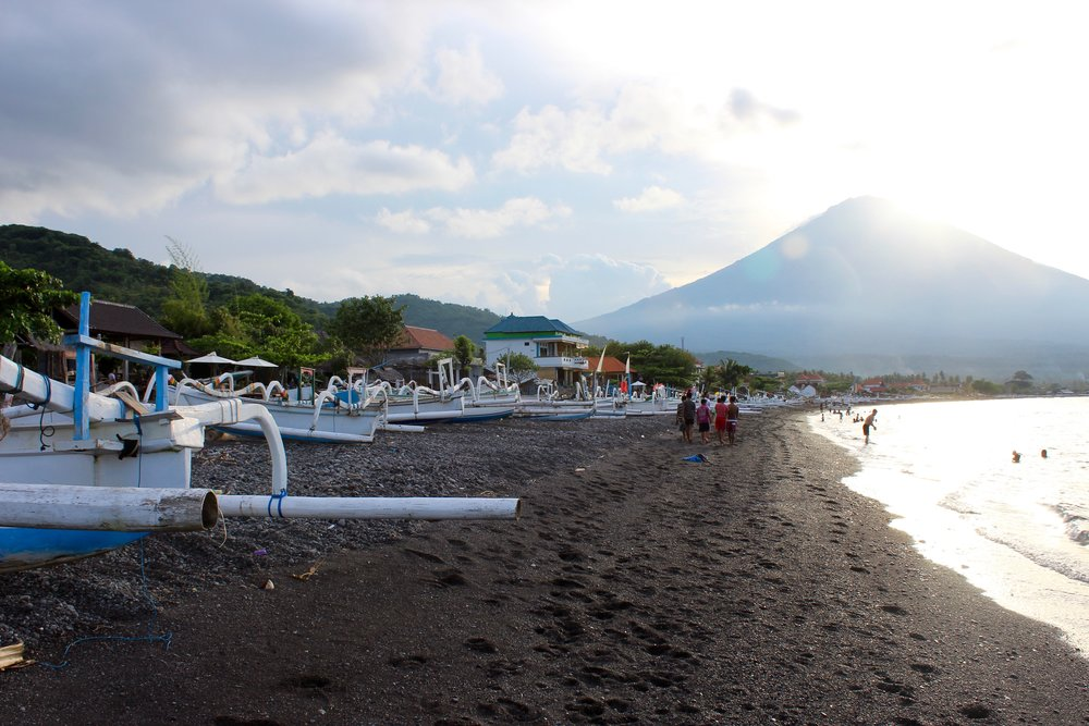 Waking by the Black Sand Beach in Amed