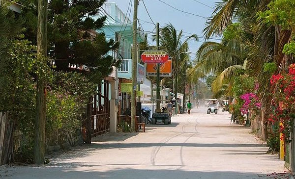 Front Street in Caye Caulker with golf carts roaming the area