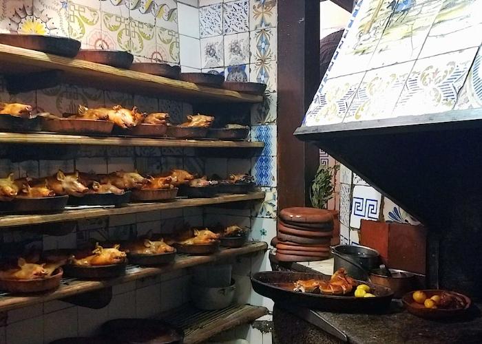 Suckling pigs in the kitchen at Sobrino de Botin, established in 1725.