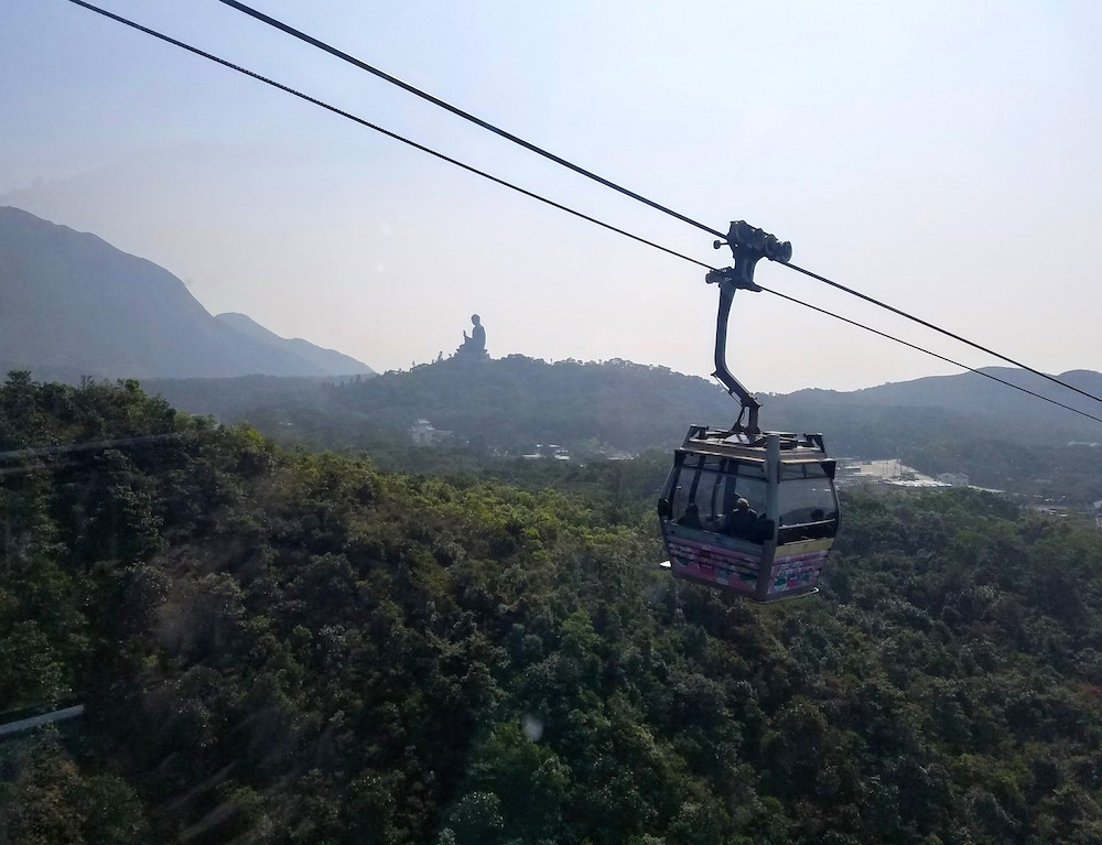 The Big Buddha in the distance, seen by cable car