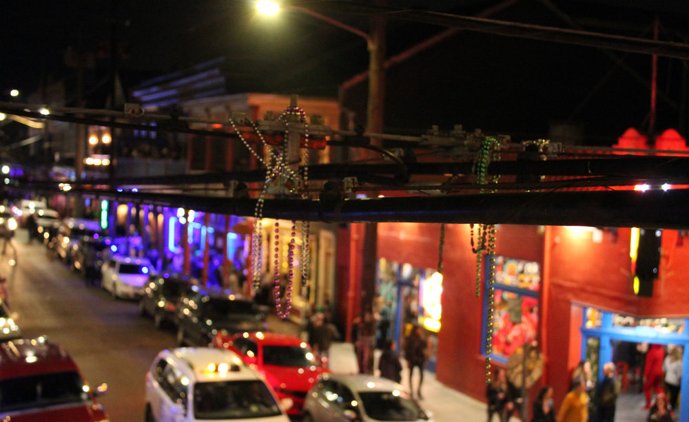 Mardi Gras beads spotted hanging above Frenchman Street