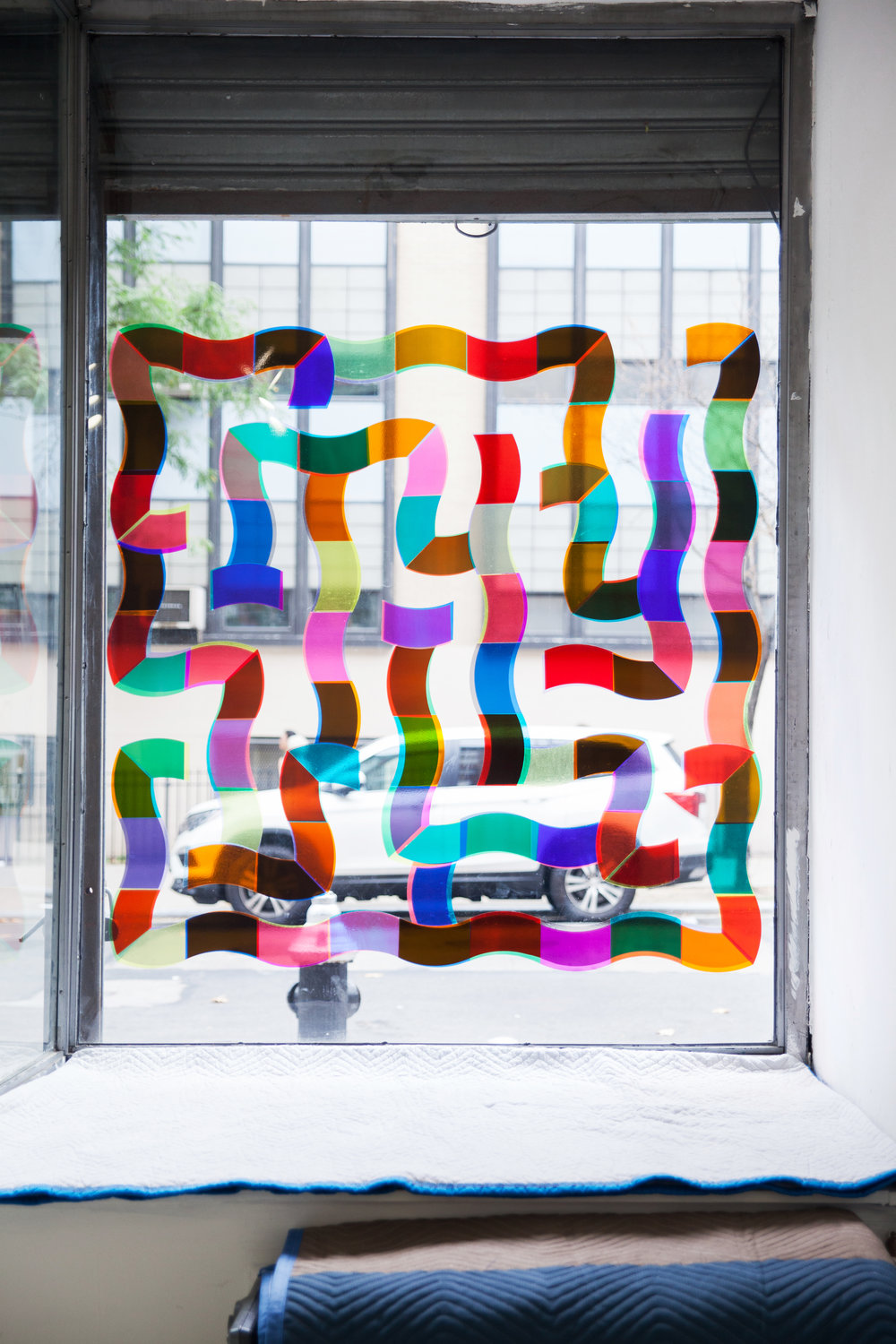 Double Trap ,  Single Use  2018 Colored transparent plastic sheets on glass Approx. 54 x 54 inches