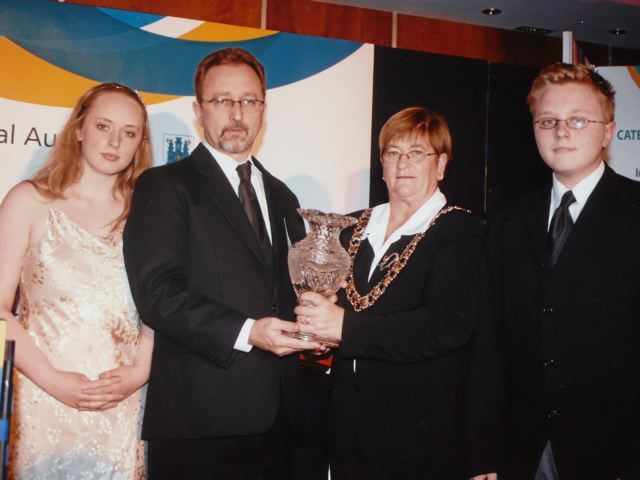 Susie posthumously named Kilkenny Person of the Year,  November 2007.  Pictured from Left: Áine, Conor and Fergus with Marie Fitzpatrick (Kilkenny Mayor).