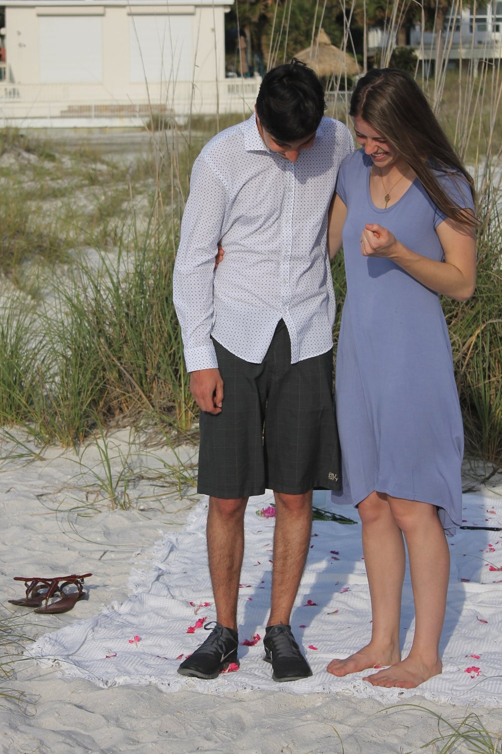 Taken moments after Steven proposed to me on the beach in Florida. I'm wearing an organic cotton dress by  Blue Canoe  (made in usa + focus on sustainable materials). Plus, there's that  Giving Keys  necklace again.