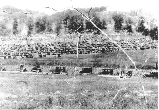 Fields filled with cars as people arrived to attend the dedication of Fort Witten, July 4, 1927.  Pisgah Church can be seen in the back left portion of the photograph.