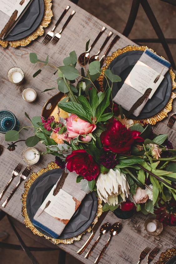 How romantic! The rich colors of this table setting definitely set the mood.