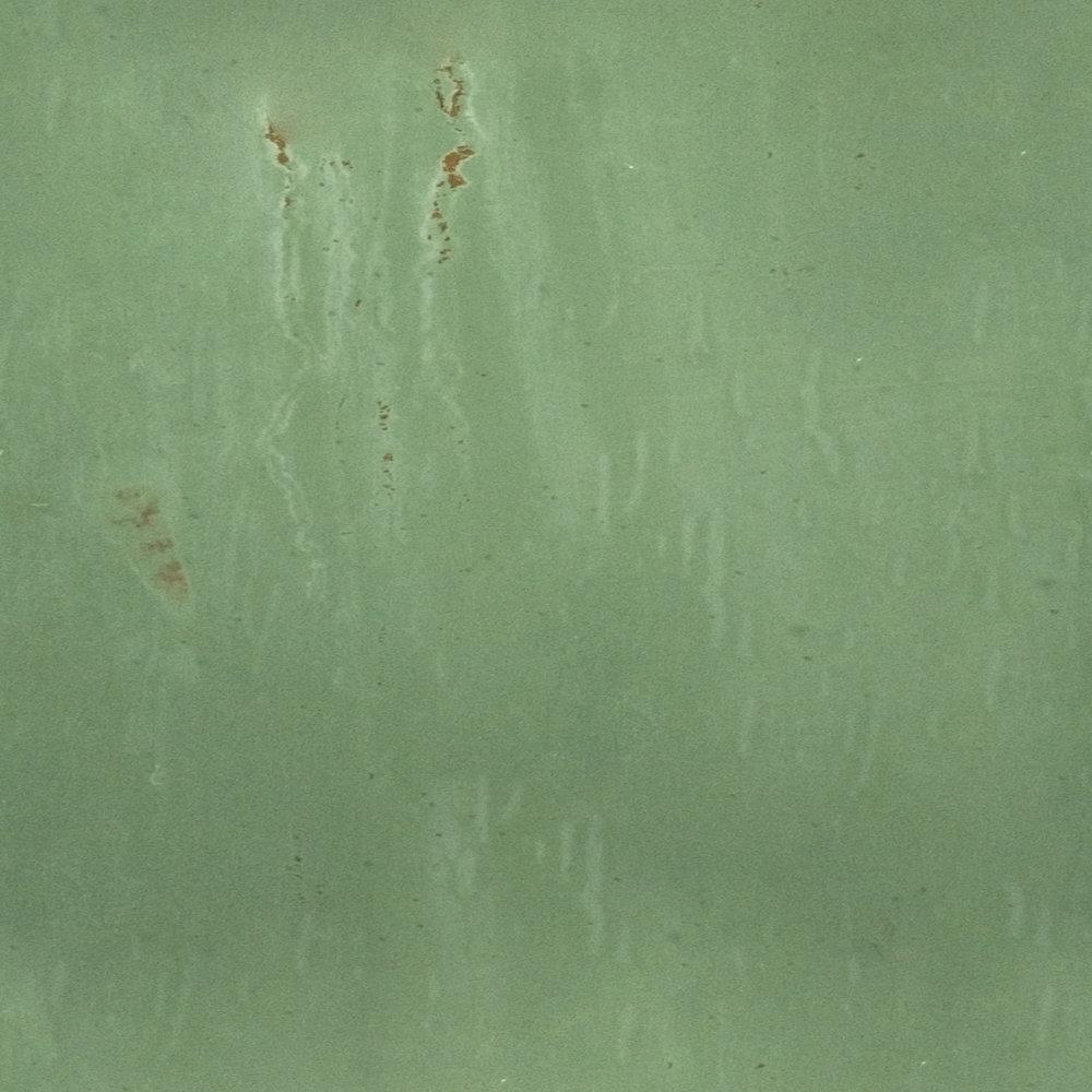 Damaged Green Aluminum.jpg