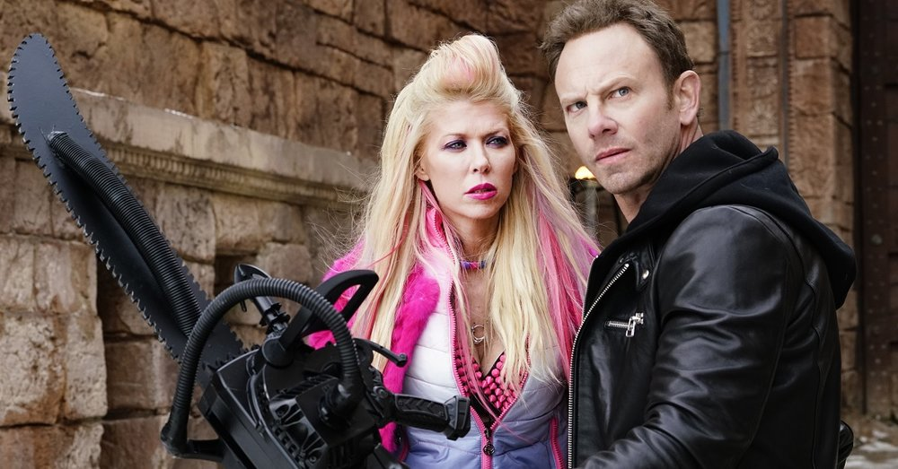 "Tara Reid and Ian Ziering in ""Sharknado 5: Global Swarming"""
