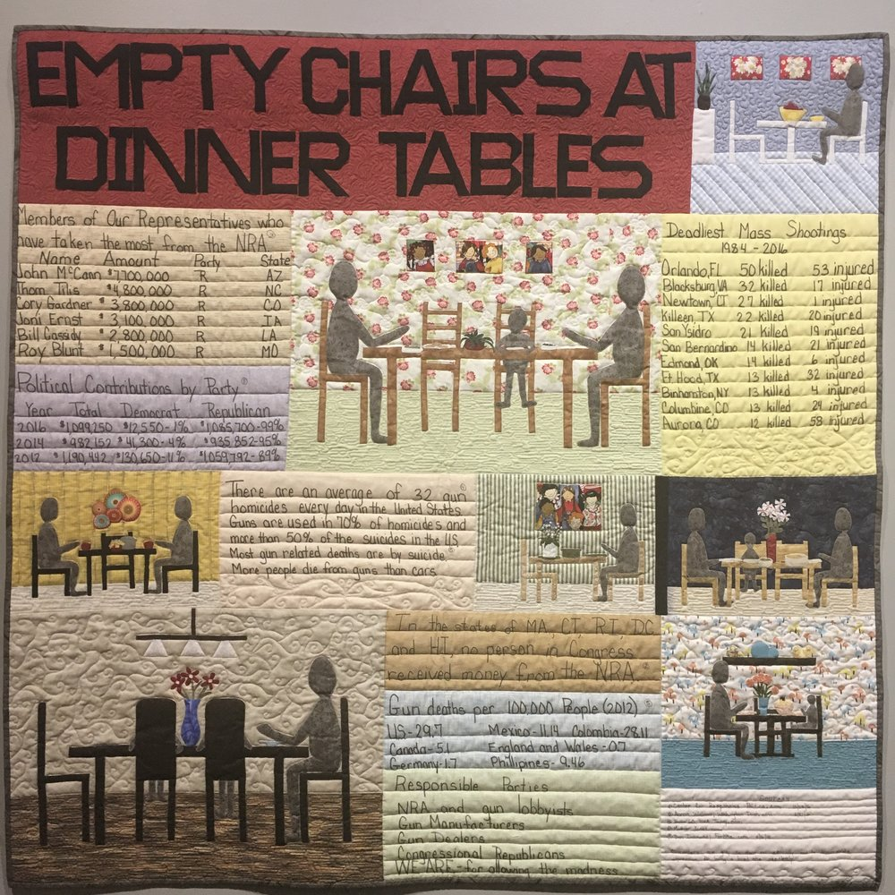 """Empty Chairs at Dinner Tables  by Joan Nicholson. Image: Namita Pau  Joan says of her evocative quilt, """"When I hear of another death by gun violence, I think of the family of the victim. They will forever live without a loved one because people in the United States have an unhealthy relationship with guns."""" She substantiates her case with data; you will find names of representatives who have taken money from the NRA, the number of gun-related deaths worldwide (as per Nicholson's research, the United States tops the chart followed only by Colombia), amount of contributions to each political party and, number of dead and those injured in mass shotings in the US between 1984 to 2016."""