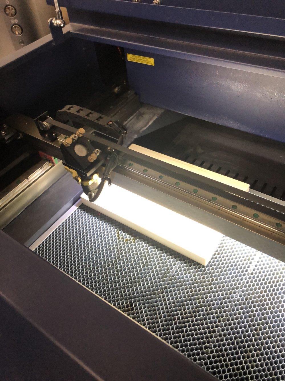 Laser woodcut on a pine block -