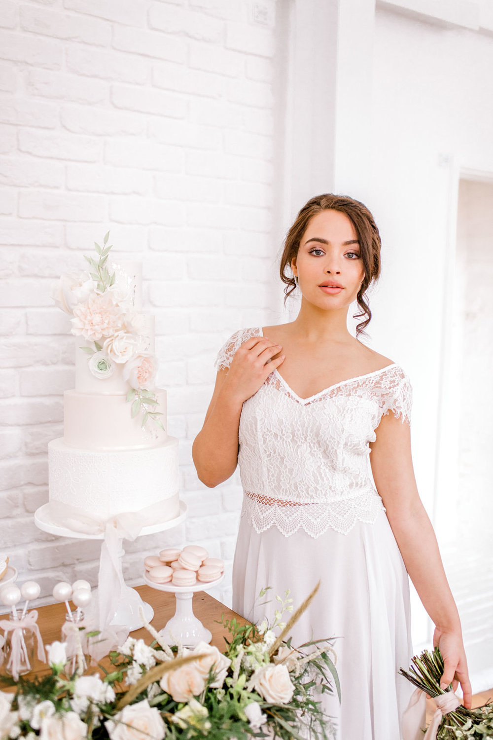 bride with wedding cake - essex wedding planner - fine art styled shoot