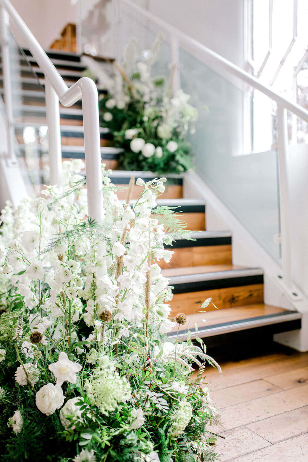 essex-wedding-planner-neutral-stairway-flower-installation.jpg