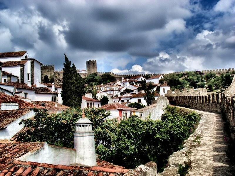 Visit the medieval village of Obidos