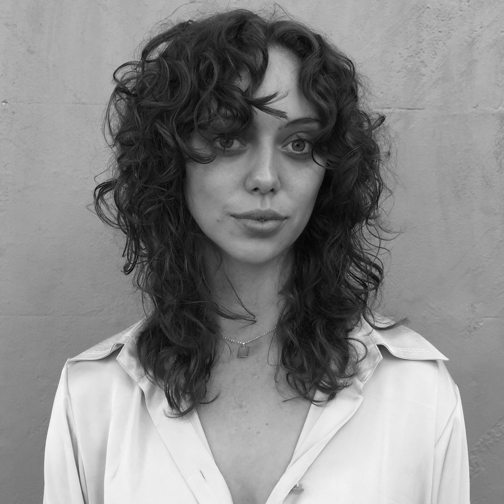 Mid-length 'shag haircut' on curls