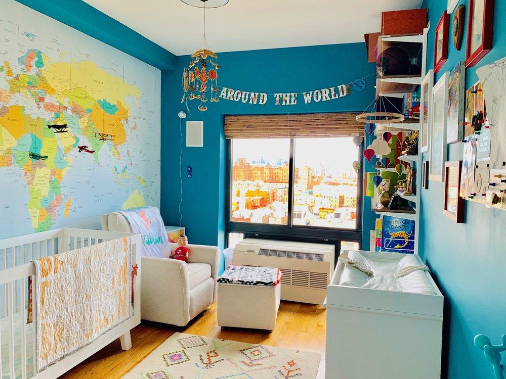 Above:   Around The World Banner ,  Crib ,  Mattress ,  Brooklyn Crib Quilt ,  Infant Monitor ,  Rocking Glider ,  Rocking Ottoman ,  Wonder Crew Doll (aka Marco)