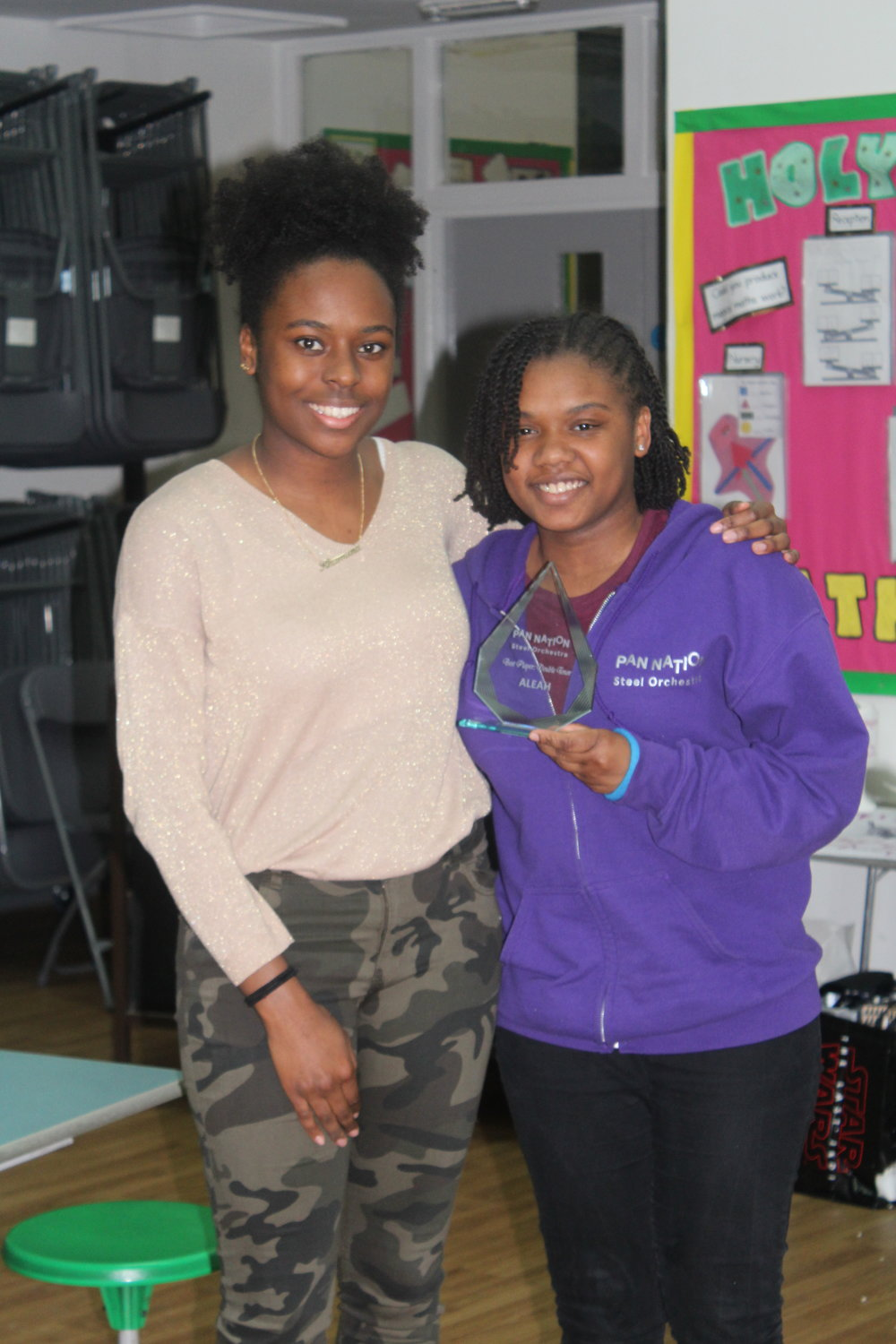 Aleah receiving her award from Rhamana, one of the vice-captains