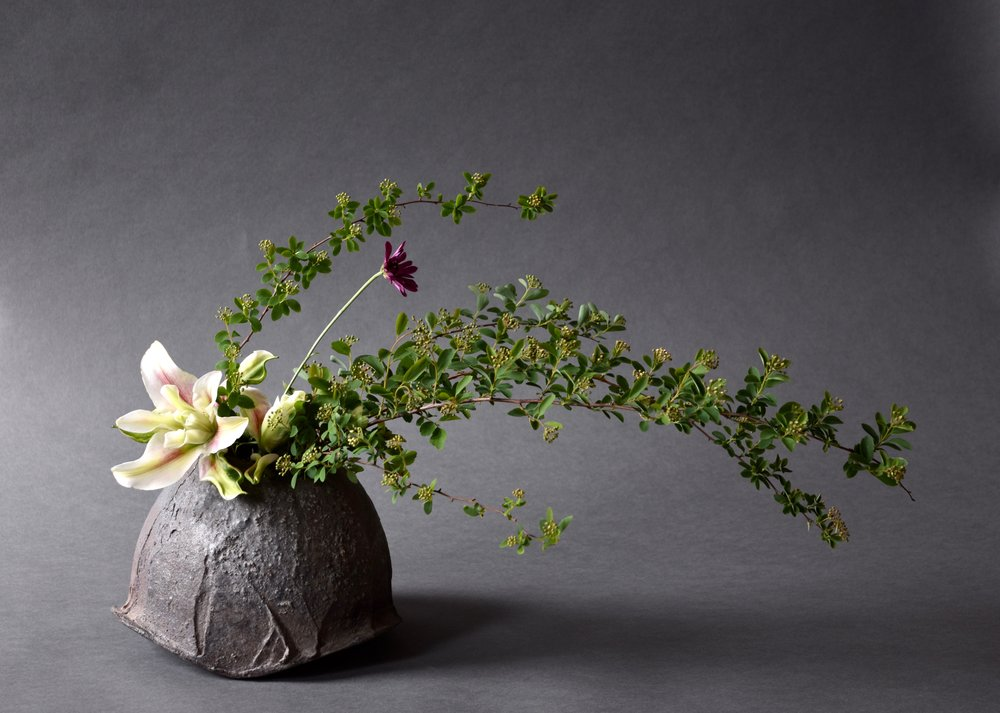 Vessel by Akira Satake and arrangement by Emiko Suzuki