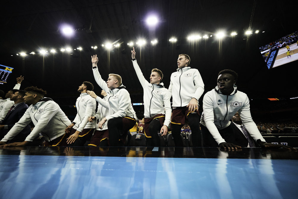The Loyola-Chicago bench celebrates a first-half three pointer.   Sony A7rIII, Sony 12-24mm f4 G