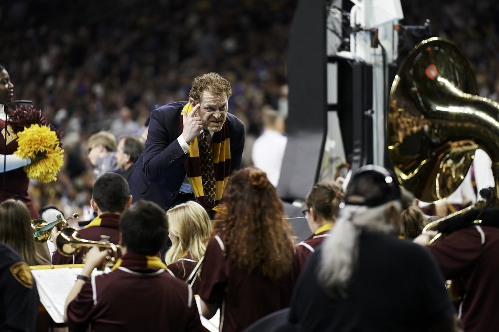 Loyola-Chicago band director Frederick Lowe makes a point of his own during the second half.   Sony A7rIII, Sony 70-200mm f2.8 GM