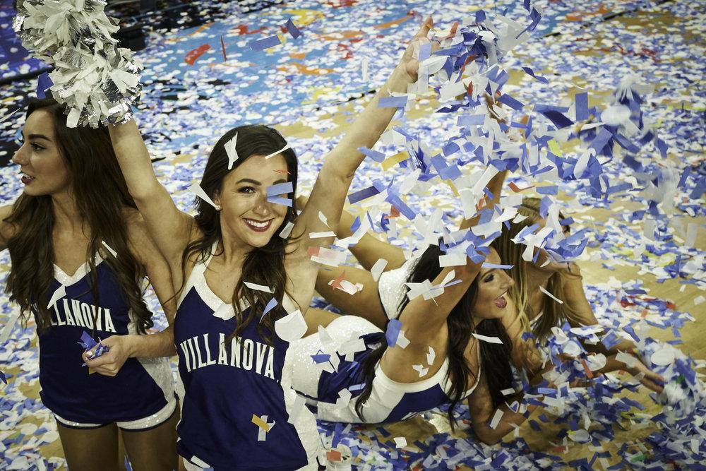 Villanova cheerleaders celebrate on a court full of confetti.   Sony A7rIII, Sony 12-24mm f4 G