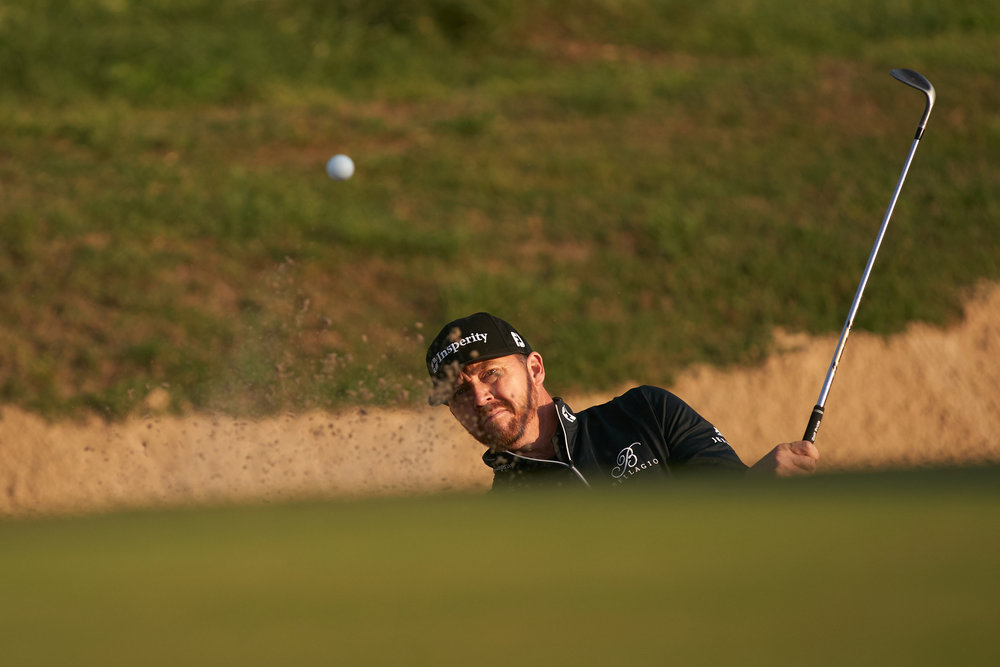 Jimmy Walker blasts out of a bunker near the 11th green.  Sony A9, Canon EF 400mm f2.8L-II
