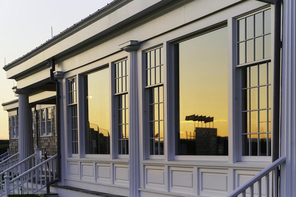 Clubhouse windows at sunrise.   Sony A9, Sony 24-70mm f2.8 GM. ©USGA/Darren Carroll