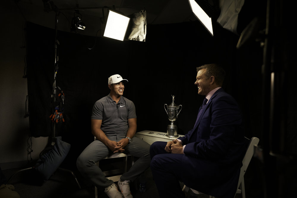 Champion Brooks Koepka joins Golf Channel's Todd Lewis for a television interview following his win.   Sony A9, Sony 12-24mm f4 G.  ©USGA/Darren Carroll