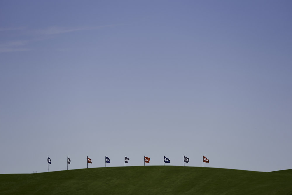 Flags at the clubhouse seen from down at the first green.   Sony A9, Sony 400mm f2.8 GM-OSS.  ©USGA/Darren Carroll