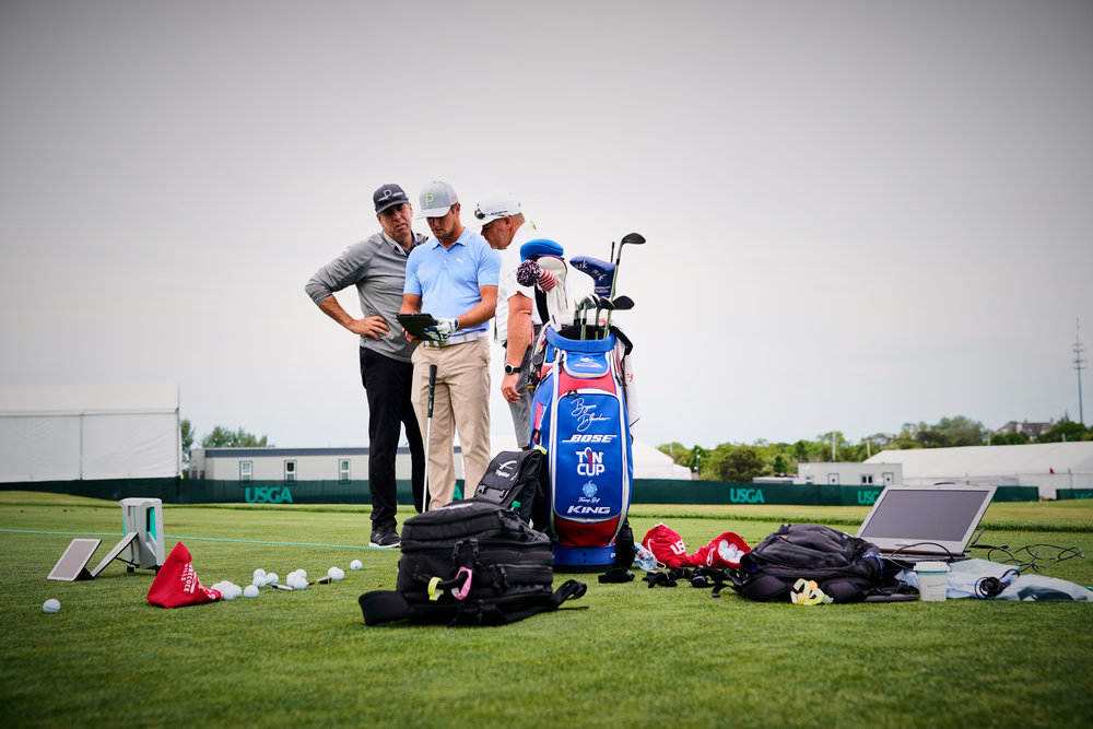In one of the most fascinating practice sessions I've ever seen, Bryson DeChambeau (center)works with coach Mike Schy (left) and caddie Tim Tucker on the driving range .   Sony A9, Sony 24-70mm f2.8 GM. ©USGA/Darren Carroll