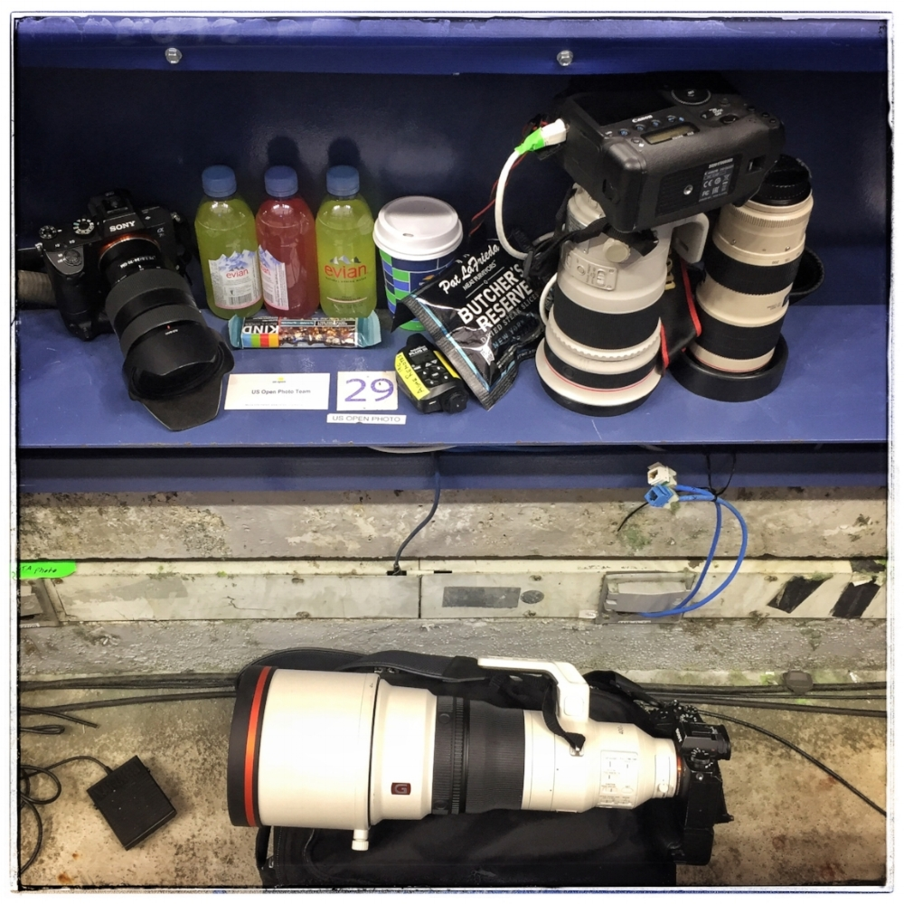 "It may seem simple when you're shooting with limited mobility, but it takes a lot of tools in the toolbox to shoot a U.S. Open. From ""the pit""—i.e. the courtside photography positions—on Ashe and Armstrong, the team elected to shoot via an ethernet tether to facilitate transmission of of images back to the editors at usopen.org, the main outlet for our work. Due to some weird technical considerations, I had to use a Canon system for this, comprising a Canon 1DX Mark 2 and either a Canon EF 300mm f2.8 or EF 70-200mm f2.8 lens. For everything else—including non-tethered shooting from pit positions—it was all Sony, all the time. Shown here are an A7rIII body with a Sony 24-70mm f2.8 GM lens and an A9 with the Sony 400mm f2.8 GM-OSS. You'll notice there's no monopod. It's so light I didn't need one. Not shown but very much in evidence in my kit for the rest of the week: Sony 12-24mm f4 G; Sony 85mm f1.4 GM; Sony 70-200mm f2.8 GM-OSS; Sony 100-400mm f4.5-5.6 G-OSS, Sony FE 1.4x teleconverter, and a Sony HVLF60 flash. That foot switch in the bottom left corner is for triggering overhead remote cameras via a Pocketwizard.  Hunkering down for a 5-setter also took some provisioning, with a cup of Lavazza coffee, Evian water with Nuun electrolyte tablets (the red stuff is caffeinated, the green is unleaded), and can we talk about the culinary discovery of the tournament? The presence of the Pat Lafrieda Meat Company at the food concession areas was already one of the gastronimic highlights of a fortnight at Flushing Meadows. Burgers, steak sandwiches and tots always did a significant amount of damage to my meal allowance. But now they've thrown some pastrami beef jerky into the mix, too?. You never know when it's going to turn into a long night…"