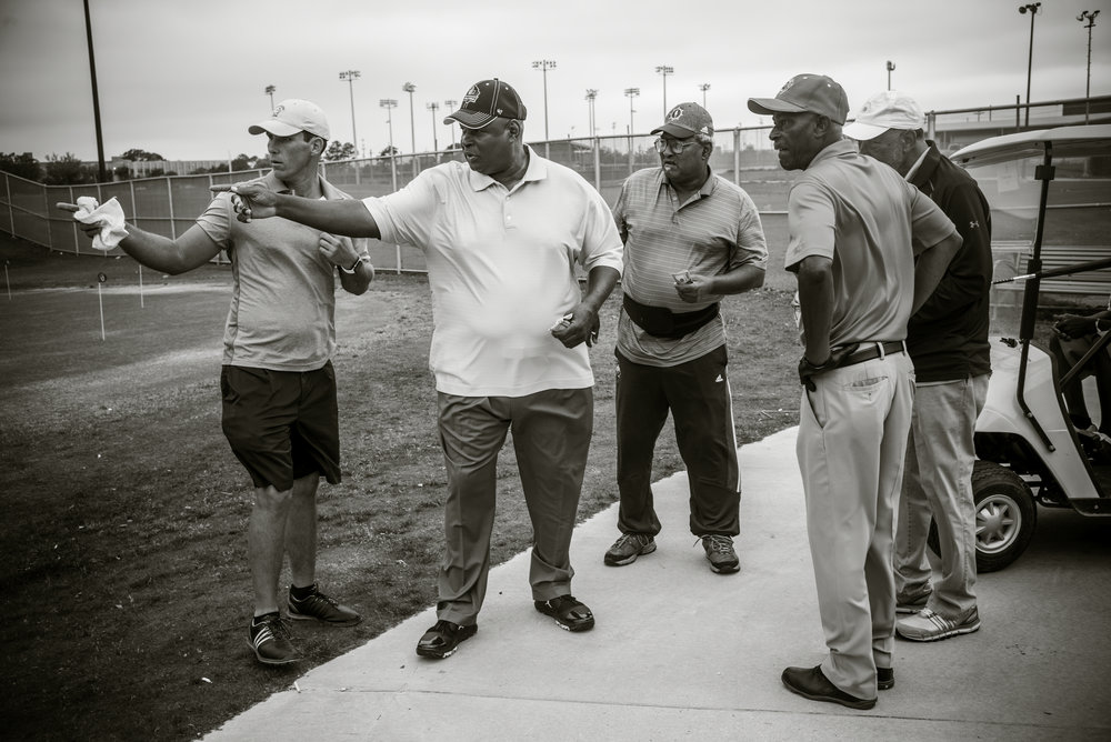 "Ricky ""Linebacker"" Jackson, second from left, and others discuss some local rules for the week's big money match."