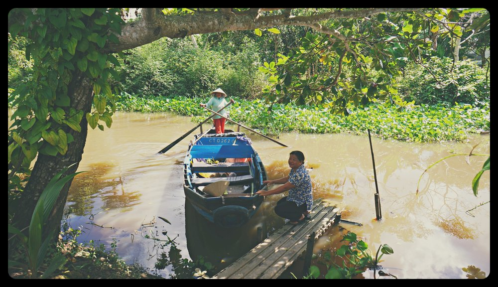 Mekong Delta trip with Mrs. Ha (on the footbridge)