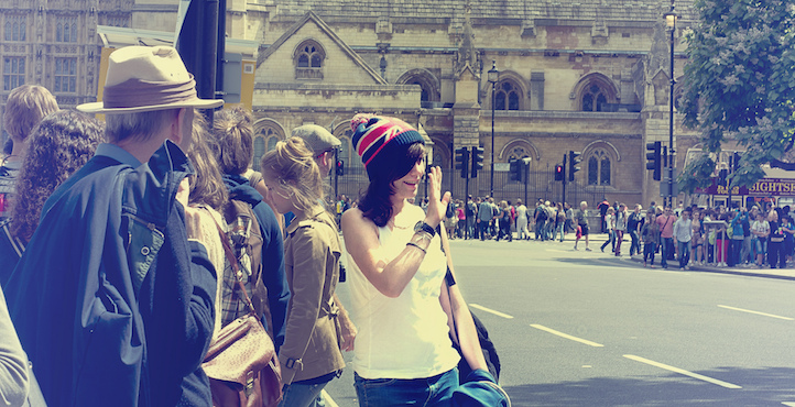 Girl waving, London, England