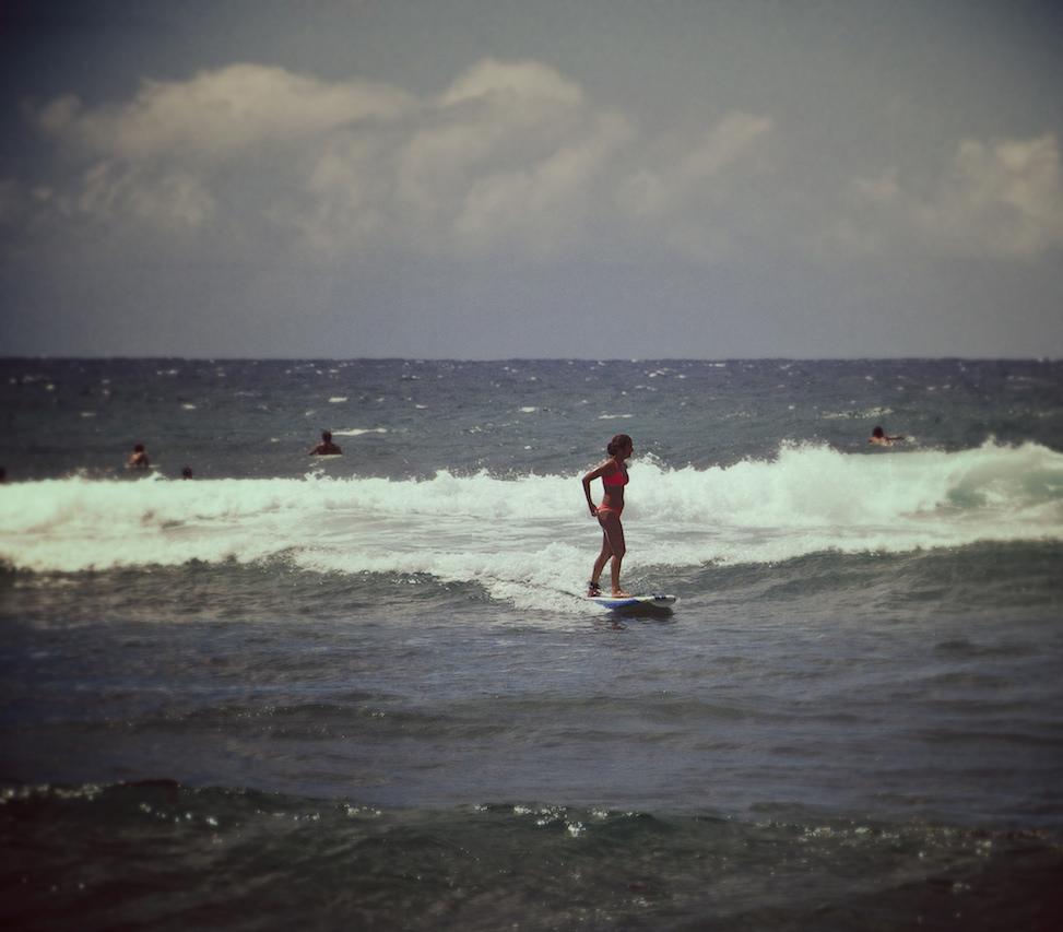 Surfing girl, Ho'okipa beach park, paia, hawaii